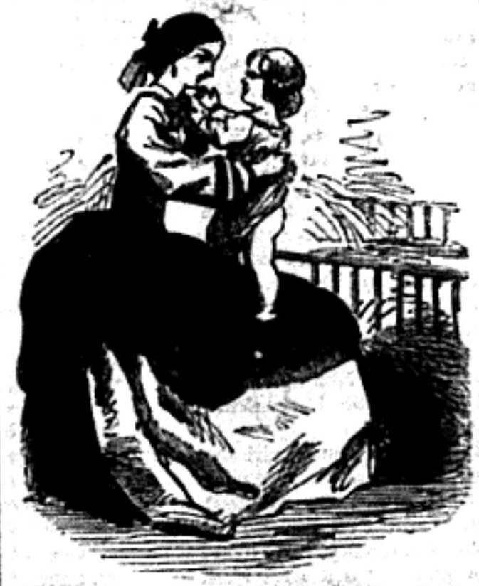 A woman holding an infant in her lap.