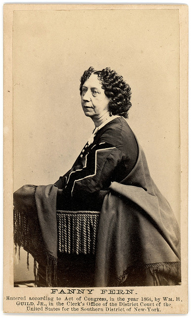 Portrait of Fanny Fern, standing, facing left.
